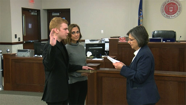 Pictured: Benjamin Reynolds '22 being sworn in.